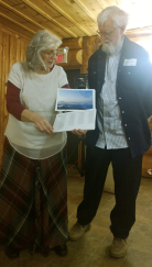"HUG Founders Lynn & Paul Hunt receive their ""Thankful"" calendar from HUG/HDT employees"