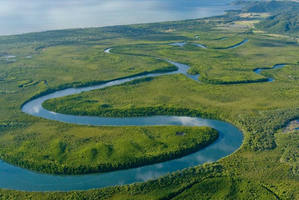 a winding river flowing through the countryside