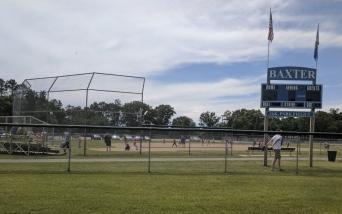 Modern baseball fields with scoreboards are all around.