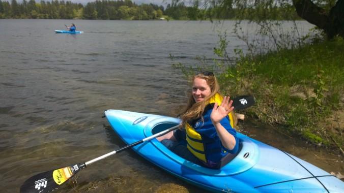 Nora Waving on Sand Lake from a kayak Pine River Minnesota