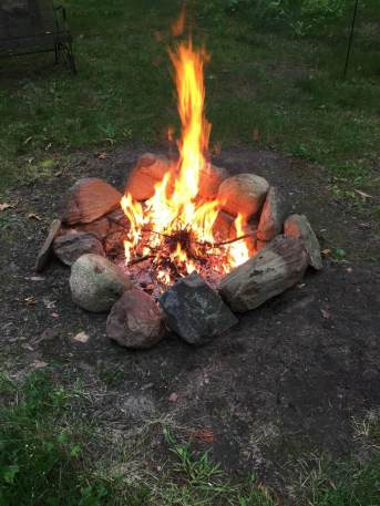 Notice the rock ring. This helps keep the fire from spreading out.