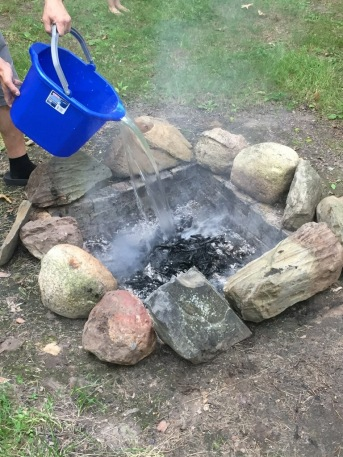 Dousing the fire with water is a great way to extinguish your campfire.