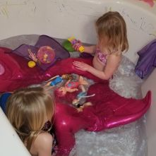 Mermaid tails! Meant for the pool, but the bath works, too.